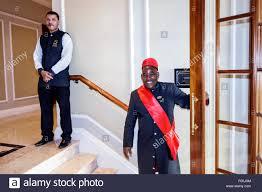 cape town south africa african city centre center wale street taj hotel doorman black man uniform holding door open