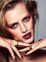 eyeshadow esther heesch shows off rouged cheeks and dark red lipstick