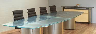 large glass conference table with ash coves stainless steel pedestals and a patterned scratched glass