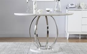 our modern savoy table adds a touch of glamour to any compact dining space
