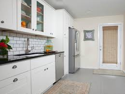 image of white kitchen cabinets with tile floors