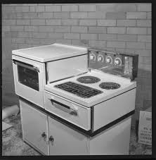 331848PD: New World side by side oven and hot plate stove, 1969 (Click