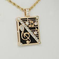 diamond note pendant treble clef