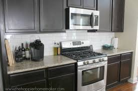 Dark cabinets, white subway tile back splash, medium toned granite |  Remodeling Ideas for Mom | Pinterest | Subway tiles, Grout and White subway  tiles