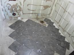 How To Tile A Bathroom Floor Video Laying Tile Floor In Bathroom Wood Floors