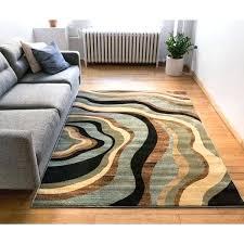 black geometric area rug well woven nirvana blue beige green black tan black and white geometric