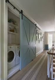 barn door laundry i wonder if this would be easier than doing a pocket door love the door color too