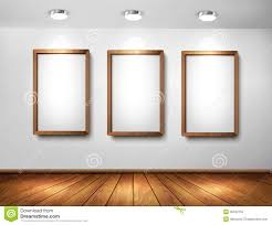 Empty wooden frames on wall with spotlights and wo