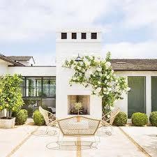 concrete patio with potted orange trees