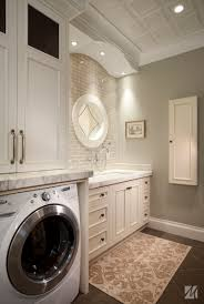 ... Laundry Room Sinks Cabinet Is Completed With Round Mirror And Brown  Carpet ...