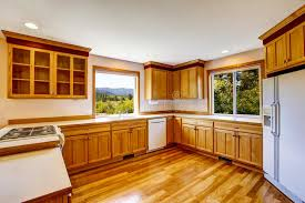 Download Light Brown Kitchen Cabinets, White Appliances And Hardwood Floor  Stock Photo   Image: