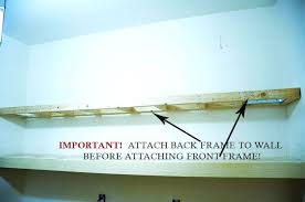after this part of your frame is securely attached to the wall and level attach the front part of the frame by ing through the front frame board