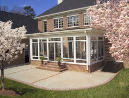 enclosed porch,outside view | Many people use sunrooms to extend the living  space of