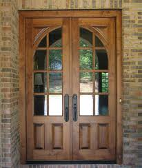 exterior glass wood door.  Door Brown Wooden French Country Double Door With Two Panel And Curved Glass  Using Black Handle Combined Brick Wall Front Doors  Intended Exterior Wood