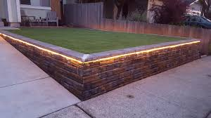1 retaining wall with warm light rope