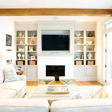 living room with tv over fireplace. Living Room Fireplace Tv Niche With Gray Built In Shelves Layout . Over V