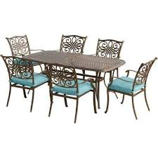 traditions 7 piece aluminum outdoor dining set with rectangular cast top table with blue