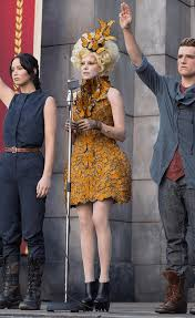 first here is a picture of the original effie trinket from the hunger games highlights of effie s attire are the erfly hair ornament erfly collar