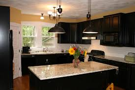 black kitchen cabinets with white marble countertops. Home, Black Kitchen Cabinet With White Marble Countertop Pendant Lamp Brickwall Backsplash Wooden Laminated Floor Cabinets Countertops T