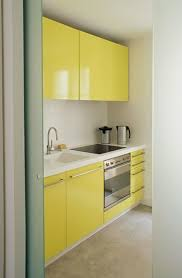 kitchen design yellow. how cheerful and unexpected is this tiny yellow kitchen? homes kitchen design y