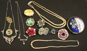a group of costume jewellery including brooches necklaces imitation pearls an h samuel quartz g