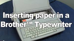 inserting paper into brother typewriters