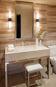 vertical fixtures or sconces mounted on either side of the mirror are best for casting an even light across the face