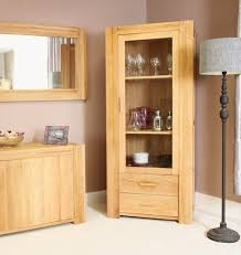 atlas chunky oak hidden home. the atlas solid oak glazed display cabinet captures popularity of furniture featuring chunky construction complemented with contemporary lines hidden home u