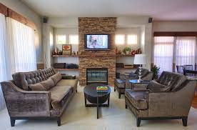 sumptuous mantel shelves in family room contemporary with stone fireplace and tv next to shelves next to fireplace alongside wall mounted tv and art above