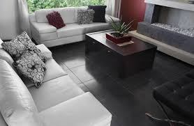 black and white floor tile room. living room with black tile and white furniture an indoor fire pit floor a