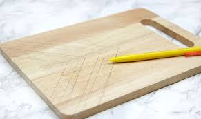 on the cutting board the simpler the better when it comes to this just because it is easy to draw does not mean that it will be easy to burn it