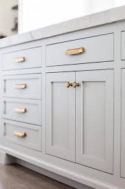 Gray Shaker Cabinets And Drawers Brass Bin Pulls And Knobs