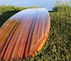 handcrafted wooden paddle boards that speak for themselves