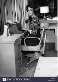 office furniture for women. People, Professions, Secretary, Woman At The Typewriter, 1950s, 50s, Desk, Smiling, Chair, Furniture, Women, Office, 20th Office Furniture For Women