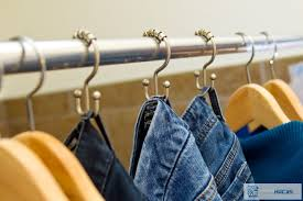 use shower curtain hooks to organize jeans for easy accessibility