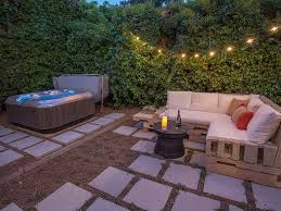 Backyard Hot Tub and Sofa. Backyard patio view from the balcony