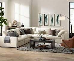 living room floor lamp. comfy sectional seating paired with a large arc floor lamp. living room lamp