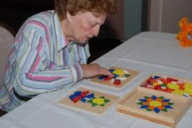 gifts for alzheimer s and dementia an older woman eing a puzzle from best alzheimer s s