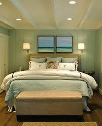 Traditional Turquoise Bedroom Completed With Brown Bench And White Quilt  Beside Blue Wall On The Hardwood