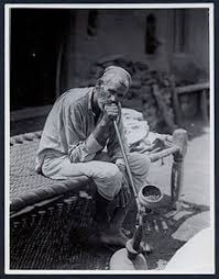 smoking in  man smoking a hookah in 1935