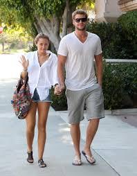 Miley Cyrus (left) (singer)