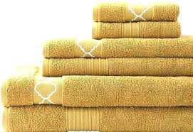 gold bath mats towels other and rugs to match yellow burnt orange resort towel white decorative