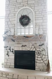 the last thing i did was hang these bats on the left side of the fireplace since the spider web was on the opposite side it looks like they re swooping in