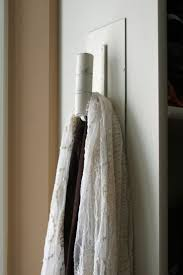 An old trowel spray painted white used to hang scarves....etc.