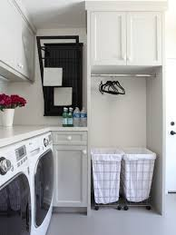 Example of a classic l-shaped laundry room design in Los Angeles with gray  cabinets
