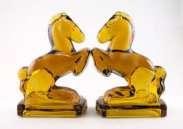 rearing horse bookends made of solid amber glass in the 1940s l e smith and fostoria