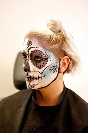 and here you have a sugar skull plete with characteristic bright colors flower petals