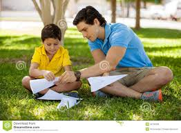 father and son making paper planes royalty stock photos royalty stock photo father and son