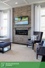 With a nod to minimalist design, the in-wall fireplace in the Bradley design
