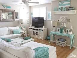 A totally beachy TV/Rec Room in white and aqua. Tour the entire cottage